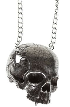 All that remains. The Remains Necklace from Alchemy of England features a jawless human skull, (with a suspiciously vampiric canine tooth), in three quarter view with a large temporal perforation, through which the pendant chain passes. All That Remains, Skull Pendant, Human Skull, Alchemy, Sourpuss Clothing, Jewelry Accessories, England, Pendants