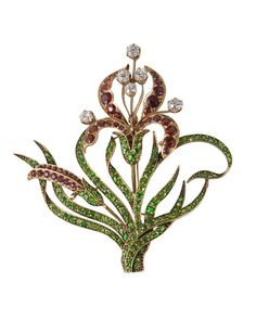 """Iris"" brooch circa 1890 in gold set with red garnets and green garnets and diamonds. With fitting to transform the brooch into an aigrette"