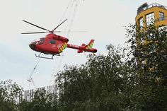 A London Air Ambulance helicopter takes off from outside the Tate Modern gallery in London on August 4, 2019 after it was put on lock down and evacuated after an incident involving a child falling from height and being airlifted to hospital. A teenager was arrested over the incident, police said, without giving any details of the child's condition. (Photo by Daniel SORABJI / AFP) (Photo credit should read DANIEL SORABJI/AFP/Getty Images)