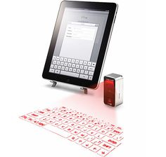 Cube Laser Virtual Keyboard for iPad & iPhone - These have been around for a while for PC. Always wanted to try one. Very cool idea.