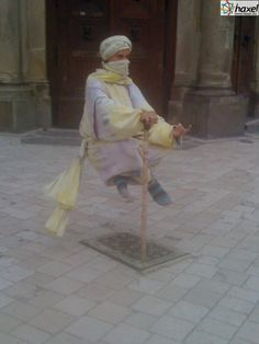 """Magician """"levitating"""" in front of the famous Mary's Basilica on the Main Market Square in Cracow"""
