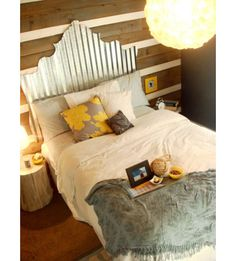 eclectic bedroom by Young House Love: Corrugated metal panels as headboard. This material has no limit to the extend of your imagination. Corrugated metal panels are easy to cut and sturdy enough to hold its shape.