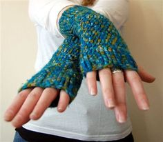 The first (and pretty much only) thing I learned how to crochet -- fingerless gloves. Wear 'em all winter long. Free pattern!