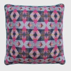 The Bricklane Cushion is handwoven by Rowenna in her London studio using  100% pure new wool. Using a complex double-cloth technique, Rowenna creates  bold, modern geometric patterns with unique colour combinations. The  cushion is backed in quality mid-grey linen, and trimmed with a contrast  cotton piping.