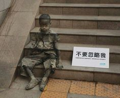 "This ghostly image (painted on the steps) is from a Unicef China ad campaign to put attention on China's 1.5 million underprivileged children. The sign beside child reads: ""Don't Ignore Me"". See more here: https://adland.tv/ooh/unicef-dont-ignore-me-print-china - Facebook"