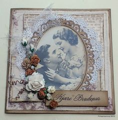 Lovely heritage romance page with intricately punched frame, lace, tulle and dimensional flowers.