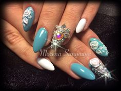 Stiletto pointed acrylic nails with gel polish hand 3d acrylic flowers, charms and swarovski crystals. #nails