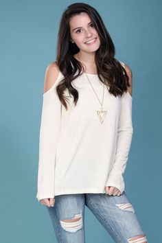 Simple, cream thermal with cold shoulders.
