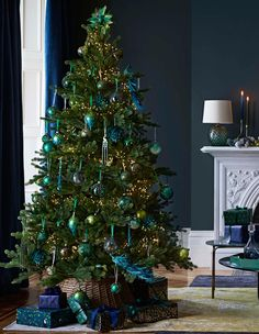 jewel tones like sapphire, teal and emerald to create a lustrous effect . Channel jewel tones like sapphire, teal and emerald to create a lustrous effect .,Channel jewel tones like sapphire, teal and emerald to create a lu. Tropical Christmas Decorations, Peacock Christmas Tree, Ribbon On Christmas Tree, Christmas Tree Themes, Green Christmas, Christmas Home, John Lewis Christmas Decorations, Peacock Ornaments, Elegant Christmas