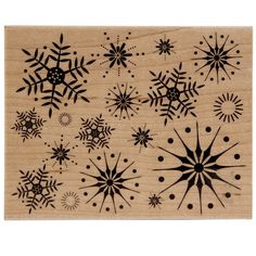 """This stamp is an assortment of sparkly, graphic snowflakes all in one stamp. It is perfect for wintry backgrounds, or ink up just one and use as a central card element. The 4.5"""" x 5.8"""" x 1"""" woodblock"""