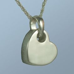 This tilting silver heart pendant also holds a small amount of cremated remains so you can keep your loved one next to your heart. How sweet! $119 and includes engraving. #funeral idea, #memorial service gift