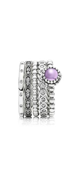 Add a bit of purple to an all silver ring stack to make it pop. #PANDORA #PANDORAring