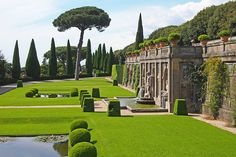 At the three-tiered Giardini del Belvedere, a group of formal gardens at the papal palace at Castel Gandolfo, the second level hosts sunken koi ponds and a fountain where classical aquatic deities fill a trio of niches.