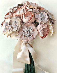 Brooch Bouquet. These last forever when fresh flowers fade. But as seen here, your florist can add brooches to your flower bouquet for sparkle and vintage elegance.
