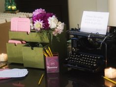 Cute typewriter and library catalogue drawers for the reception table