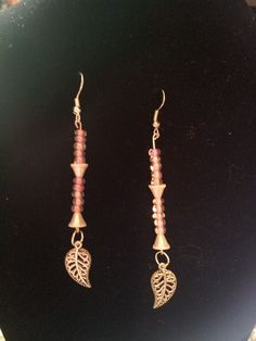shell spacer beads with pink seed beads and silver leaves.