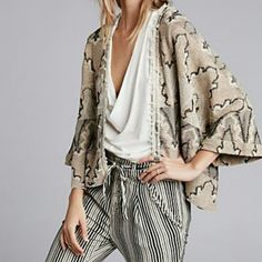 NWT Free People Butterfly Kimono Cardigan NWT Free People Butterfly Kimono Cardigan in black combo. Lightweight kimono cardigan with open front. Never worn perfect condition. 54% cotton/30% rayon/16% polyester. Free People Jackets & Coats
