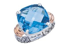 Alisa – 18kt and Sterling Blue Topaz Ring.  Casual elegant. Larger cushion shaped blue topaz two tone. Silver and gold ring made in Italy. #alias #stjohnsjewelers