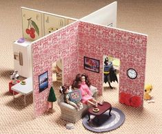Dollhouse made from two pieces of foam core. Easy to pack flat and store or tote.