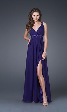 A low cut V-neckline, beaded empire waist, and unique strap design framing the open back gives this elegant evening gown a look you'll love for your 2012 prom or formal
