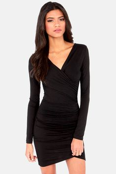 """Let us tell you a tale of two pretties: you and The Best of Times Black Dress! Indulge yourself in this soft, stretchy knit that swoops across from a surplice bodice to gathering at the side for maximum bodycon curve-appeal. Long sleeves are suitable for chilly weather, with a sexy tulip style skirt below. Unlined. Model is 5'10"""" and is wearing a size small. 96% Rayon, 4% Spandex. Hand Wash Cold  or Dry Clean."""