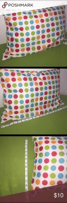 Polka Dot Accent/Child Pillow This is a SUPER cute white pillow with blue, green, red, and orange polka-dots. There is a zipper on the side in which you are able to take the insert out (or replace). There are no stains or spots anywhere. NEVER USED. CASE+INSERT in this listing! Other