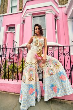 This set features an ivory silk jumpsuit with a delicate butterfly winged neckline and cut-outs. Hand embroidered doorways in neon pops of sequins, acrylics, and glass beads. Neck: Sweetheart Neck Sleeve Type: Strap Fabric: Raw Silk Care: Dry Clean Only Indian Wedding Outfits, Indian Outfits, Indian Clothes, Emo Outfits, Indian Attire, Indian Wear, Indian Designer Outfits, Designer Dresses, Indian Designers