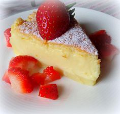 Magic Custard Cake 4 large free range eggs at room temperature, separated 1 TBS water 150g caster sugar (1/2 cup plus 2 TBS) 125g of butter, melted (1/2 cup) 115g of plain flour (3/4 cup) 500ml of milk at room temperature (2 cups) 2 tsp vanilla extract To serve: icing sugar to dust fresh berries