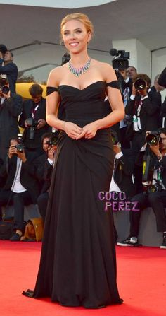 Scarlett Johansson in a black, off-the-shoulder Versace gown and a Bvlgari necklace