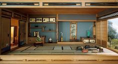 This traditional Japanese room has subtle Zen influences, such as organic wood surfaces, a large layout, and open views of nature.