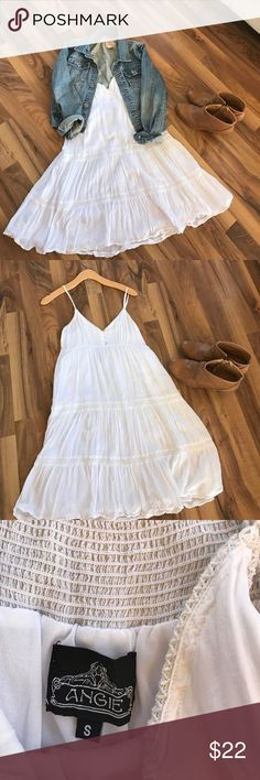White sundress This dress is adorable! Cute and flattering. Has adjustable spaghetti straps. Cute with cowboy boots and Jean jacket. Was purchased at a fun boutique! Dresses Mini