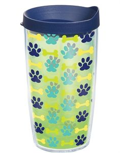 The sweet Tervis Puppy Prints 16 oz. Wrap Tumbler with Lid features paw prints and bones in multiple colors in a wrap-around design. comes with a lid.