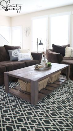 Build a DIY Crate Coffee Table on wheels! Easy build and perfect for recycling old pallets! Free plans at www.shanty-2-chic.com