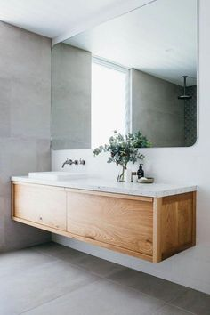 This gorgeous custom floating timber vanity made f .This gorgeous custom floating timber vanity made f . - Custom Floating Gorgeous mirror timber Luxurious Coastal Home: Kyal and Long Laundry In Bathroom, Bathroom Inspo, Bathroom Renos, Bathroom Renovations, Bathroom Interior, Bathroom Grey, Bathroom Storage, Vanity Bathroom, Bathroom Organization