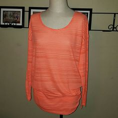 Maurices In Motion Long Sleeve Athletic Top Maurices brand. In Motion- Maurices Athletic Line. Size 0- Plus Size.  Orangish/Coral color striped. Semi-sheer material. Extra wide waist band with ruched sides provides extra coverage while working out.  Excellent condition! Maurices Tops