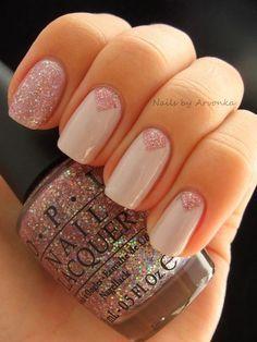 Nail art gel in a triangle and glitter design...x