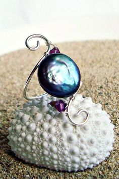 Sterling Silver Wire Ring This would not be adjustable, but it sure is beautiful.  Love the pearl.