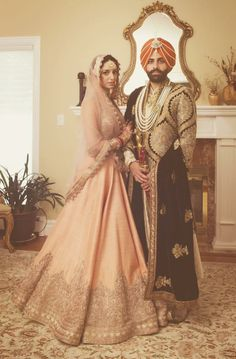 Bride Wearing A Peach Embroidered #Lehenga For Her Sikh Wedding. RB Photography. raw silk