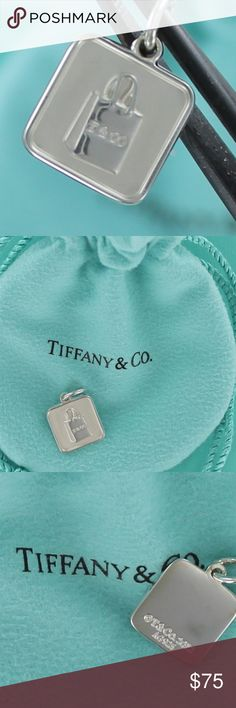 Tiffany Lexicon T&CO® Shopping Bag Charm Pendant PRICE IS FIRM!   100% Authentic   Tiffany & Co. Lexicon T&CO® Shopping Bag Charm / Pendant  Sterling Silver  Tiffany pouch, box, and brand new gift bag included with purchase. Tiffany & Co. Jewelry Bracelets