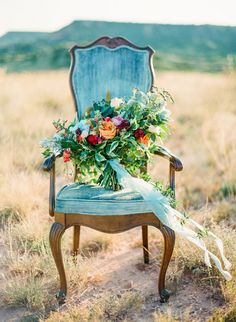 Colorful Bohemian Bouquet in a Vintage Velvet Chair | Joshua Ratliff Photography | http://heyweddinglady.com/colorful-bohemian-bride-magic-hour-shoot/