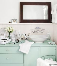 Bathroom.  Sideboard turned vanity (great color).  Mirror propped on ledge. Accessories.  I love everything!