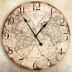 take an old world map poster and use a round wooden circle and add hands, numbers and workings required to build a clock or cover a modern one and put back together?