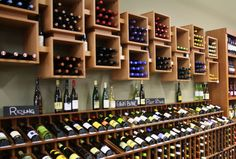 These wall mounted wine cubes were installed for a retail liquor store. Their simplicity allows your wine to be the center of attention! #wine #Vigilant