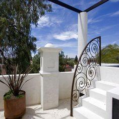 Stunning wrought iron handrail into pool area
