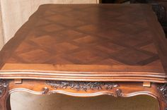 Antique French Louis XV over sized draw leaf refectory table. Circa early 1900's. Walnut. Parquet top. Carved apron with floral motifs resting on elegantly shaped cabriole legs ending in escargot feet.