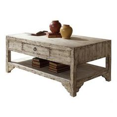 A delightful canvas for fresh wildflowers, sepia-toned photos, and vintage d�cor, this design is a warmly weathered addition to your home.  Product: Coffee tableConstruction Material: WoodColor: Distressed taupeFeatures:  One drawerCircular drawer pullsOpen bottom shelf Dimensions: 20 H x 28 W x 48