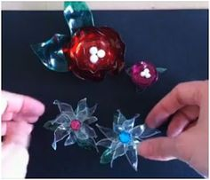 Very cool got to try!    Posted by  Pearl Blay      on  Thursday, November 10, 2011            Plastic Bottle Flowers     New readers might be aghast at the thought of using plastic in jewelry let alone recycled water or pop bottles.    But some artisans do make incredible jewelry