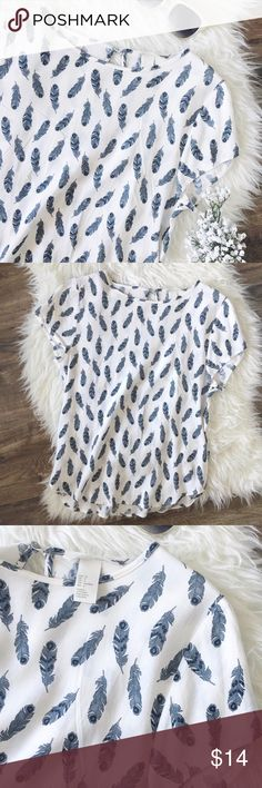 h&m • feather blouse with back keyhole Super cute top from h&m. It's white with black and gray feather design. It's not very see-thru as you can see in 4th photo. Single button on the back with a keyhole. Excellent condition. Size 4 H&M Tops Tees - Short Sleeve
