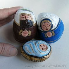 Nativity set painted on rocks with metallic accents