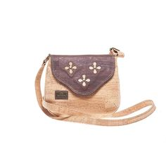Vegan Cork Crossbody Bag with cut out flowers on the flap, constrasting in color. Eco-friendly, durable and made in Portugal. Montado – Cork Fashion.